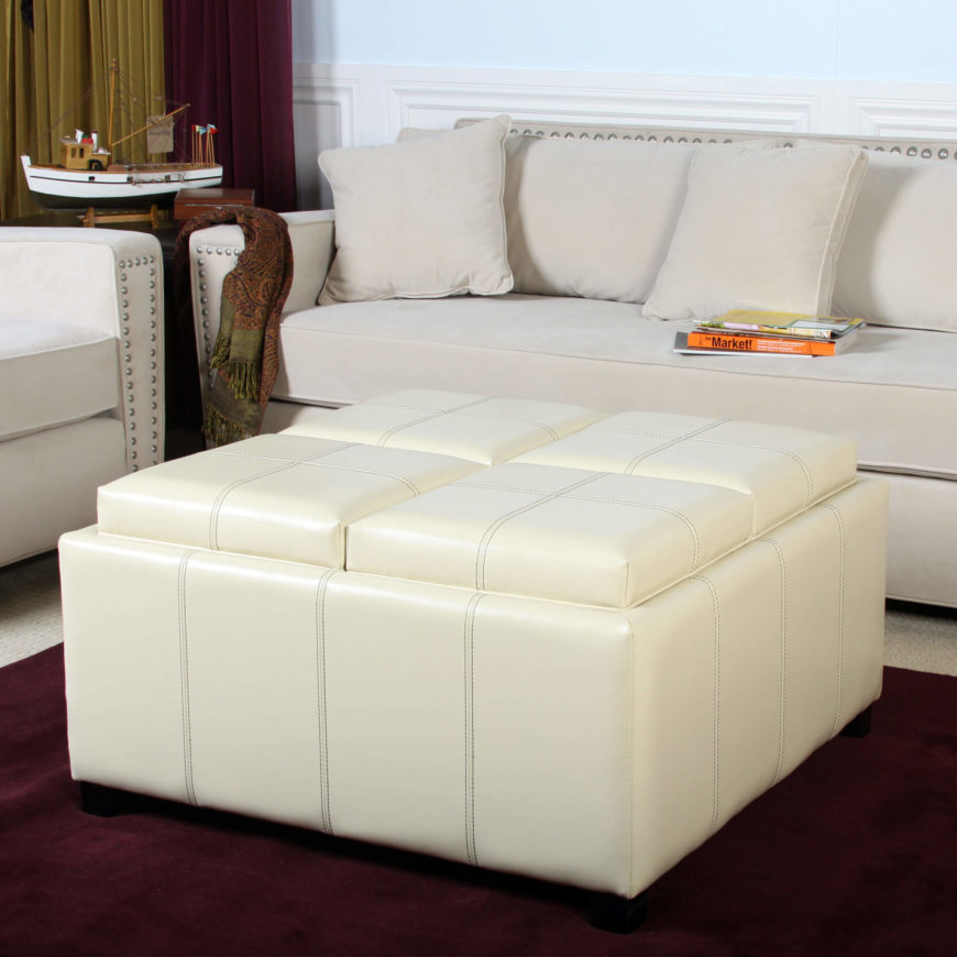 A simple square ottoman with four separate wooden trays below the tops. This is a perfect example of an ottoman turned coffee table, and a great space-saver!