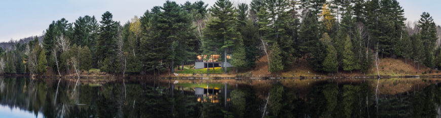 We leave you with a panoramic view of the home and surrounding property, looking over the lake.