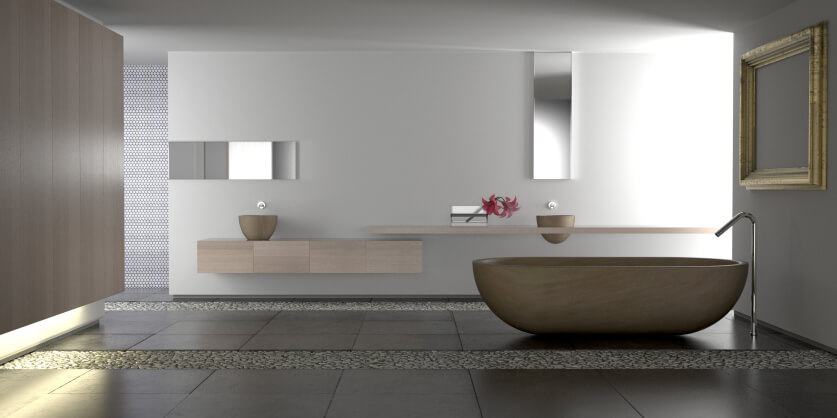 This sleek, minimalist bathroom houses a singular bowl-shaped pedestal tub at center, with floating vanity agains the far wall. Strips of stone divide the dark large format tile flooring.