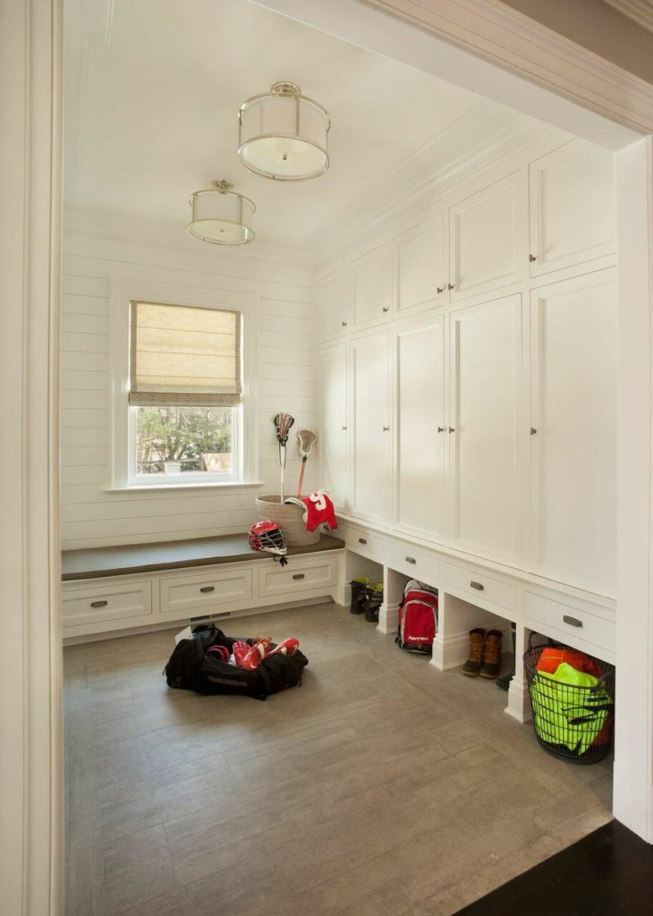 The home's mudroom is in white with individual storage lockers and small cubbies beneath each locker.