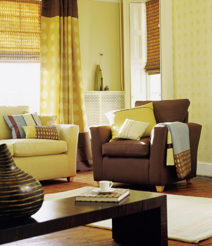 A simple leaf motif on the green and chocolate brown curtains echoes the matching motif on blankets and throw pillows.