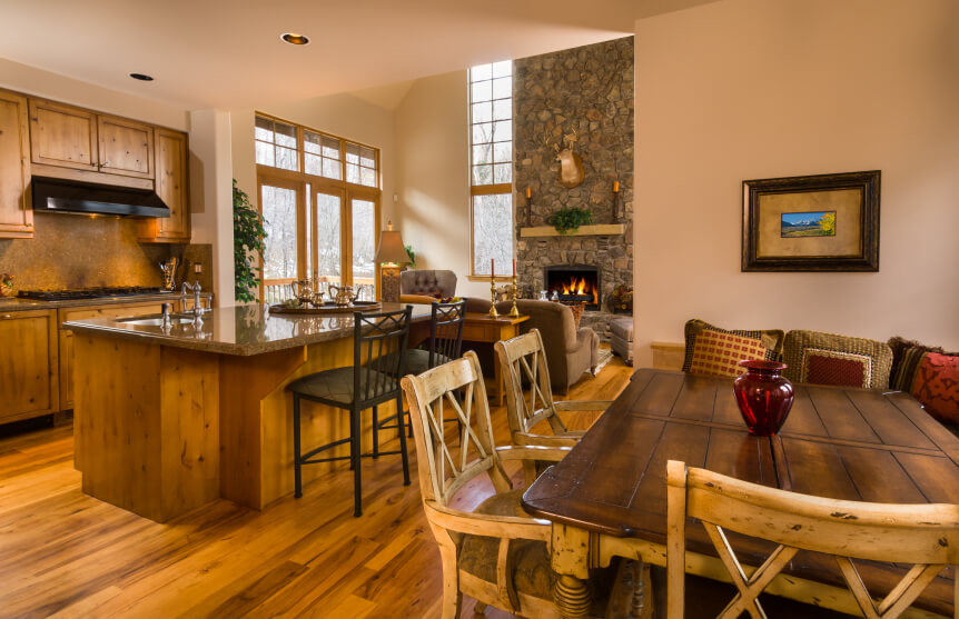 This beautiful country home has a striking hardwood flooring with lots of knots for that rustic look. The dining area and cabinets also feature knotted wood for a general traditional atmosphere.