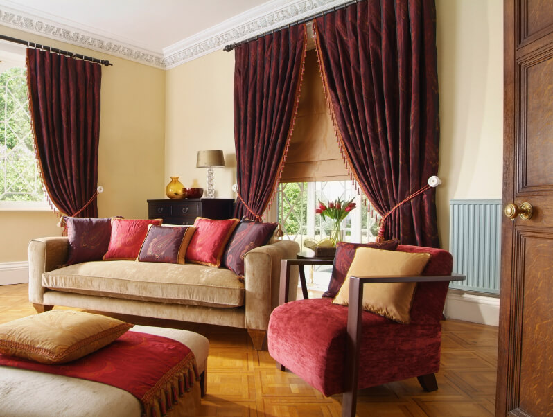 Thick drapes are a hallmark of traditional design, and go well with the parquet floor and crown molding.