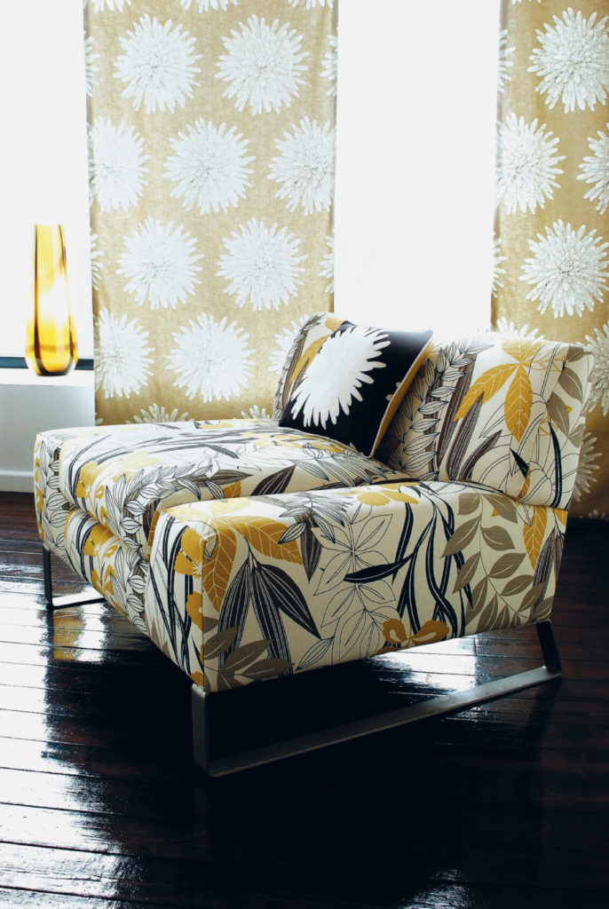 Paired with a bold floral print armless chair, these more subtle dahlia curtains act as a complementary piece.