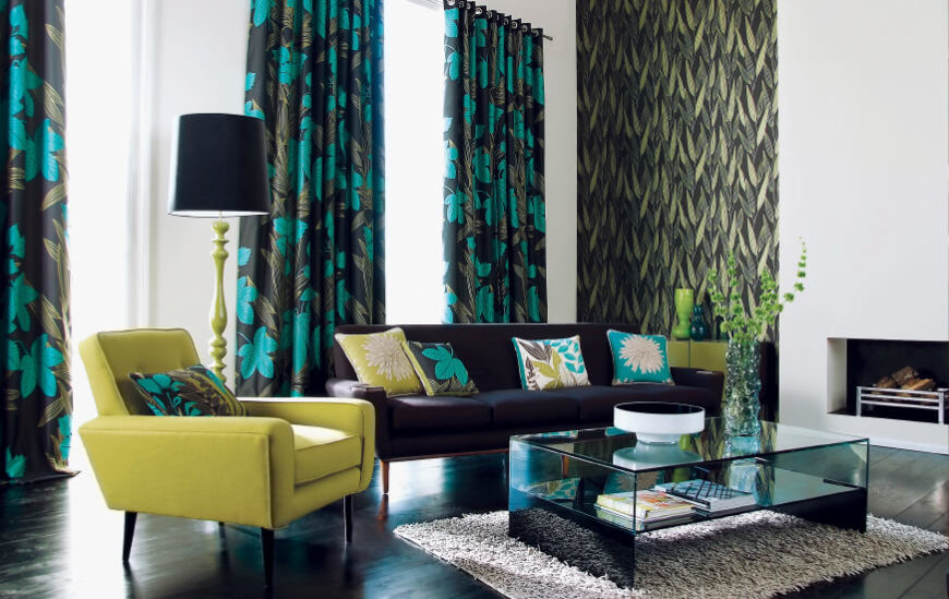 Another instance of bold floral curtains that match accents in a modern living room.