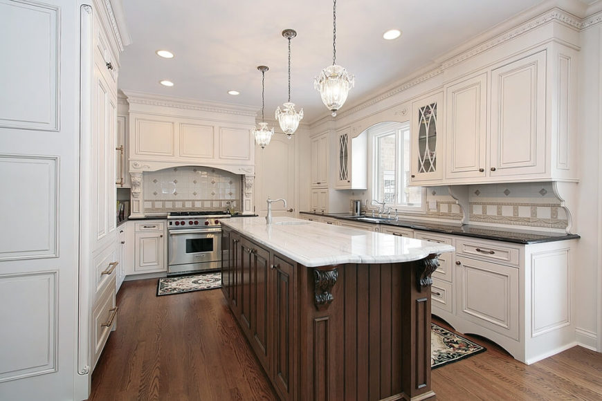 This dynamic home has polished white cabinets and drawers with intricate designs hidden in the walls. The natural hardwood floor brings a real elegance to this space.
