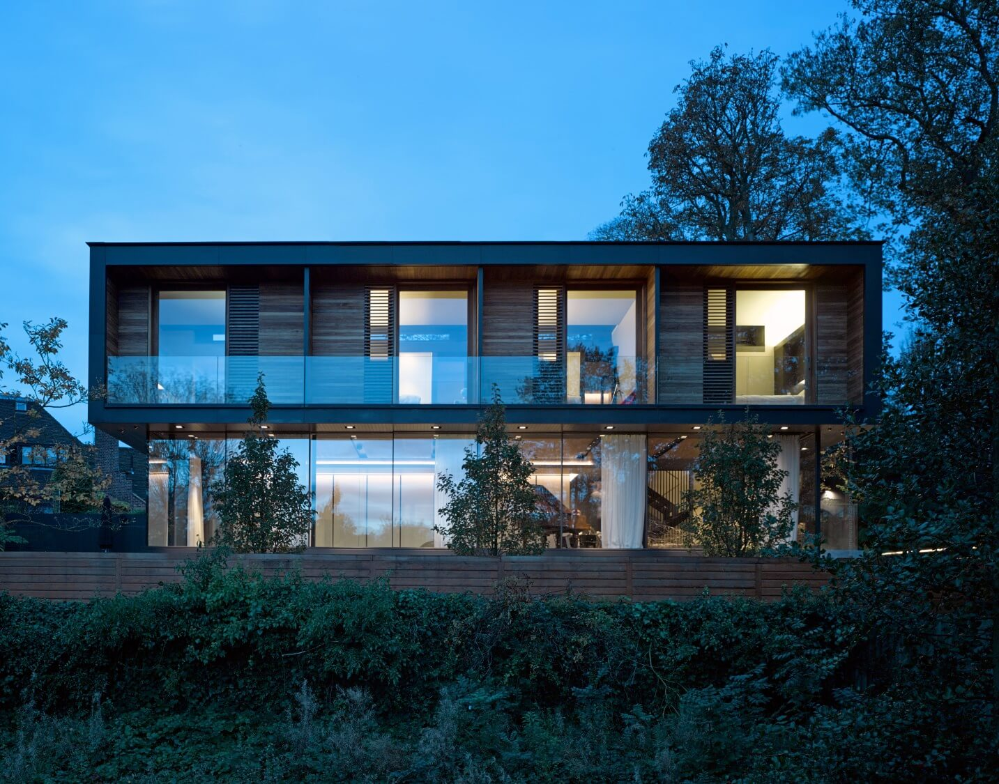 The box-like structure stands both apart and within its natural environment, via sharp angles and natural materials.