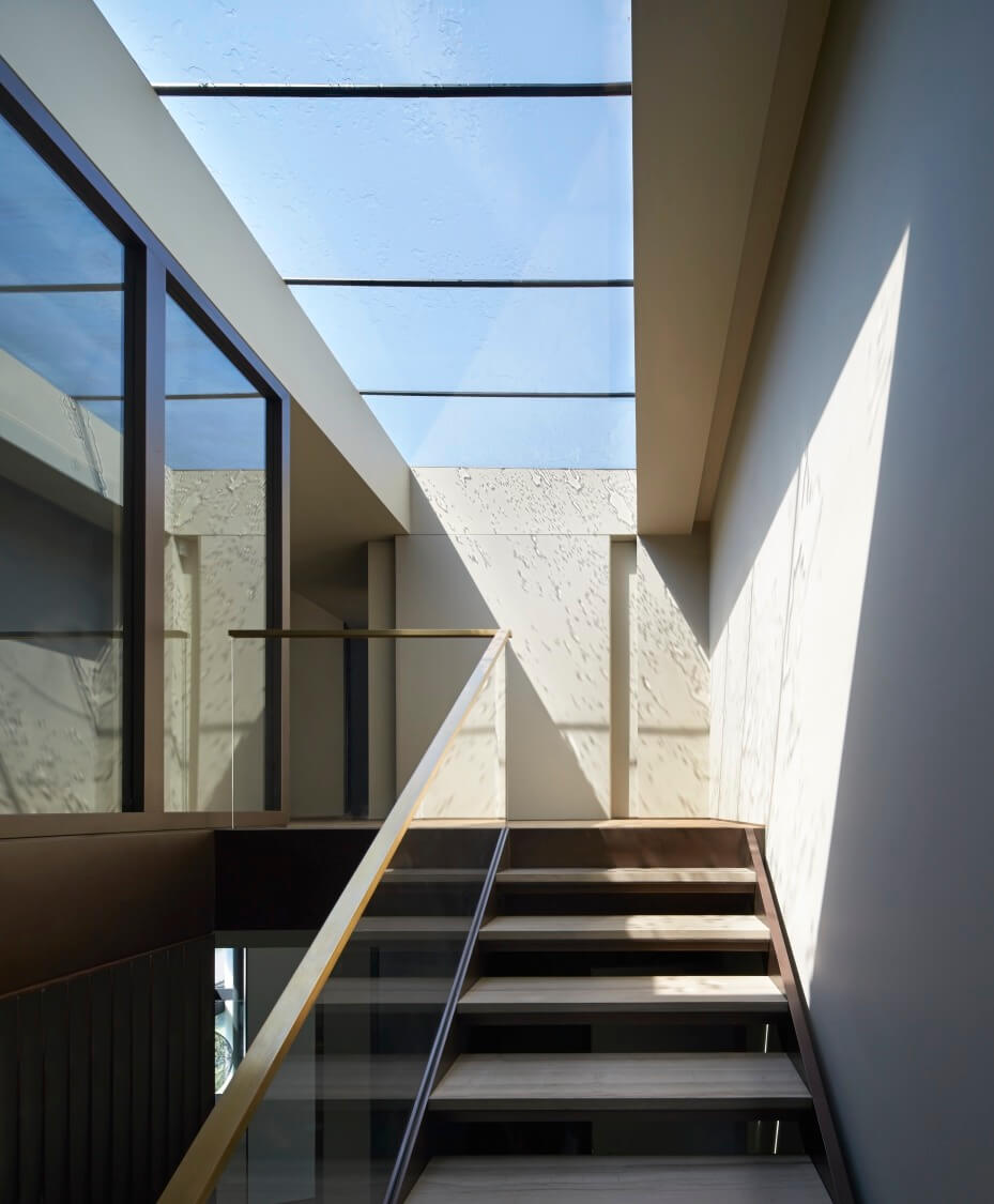 At the top of these stairs, we see another set of skylights, a lengthy aperture allowing plentiful sunlight into the home.