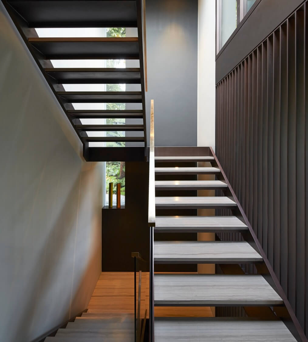 The stairway void is topped by another skylight, allowing sunshine to cascade through the open design staircase.
