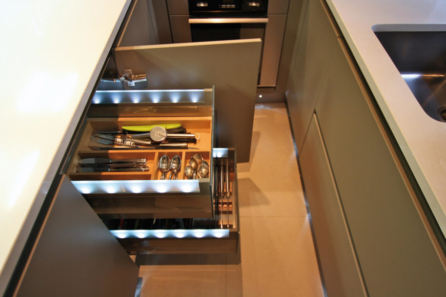 Here we see the innovative use of LED lighting, illuminating the cutlery drawers from within.