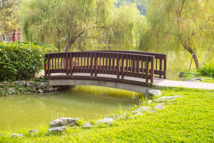 A slight arch keeps this bridge from feeling flat, but allows it to blend in with a quiet, subtle environment.