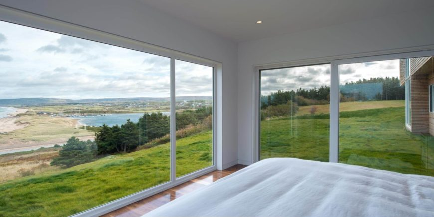 The primary bedroom is of simple, minimalist design, with expansive seamless windows for the best view in the house.