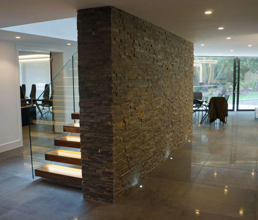 Here we see the central stone brick wall, a support structure to which the floating staircase was mounted. It also functions to divide the first floor spaces.