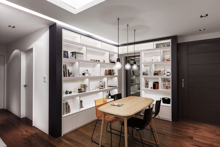 The subtle lighting scheme continues into the bookshelves as well, with each space lit from within.