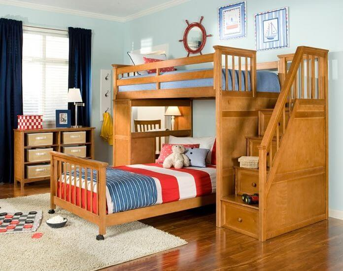 Here we have an elegant, natural wood bed with a set of stairs to the upper bunk, comprised of covered drawers for extra storage. The slide out lower twin bed fits between the steps and a study desk on the side of the unit.