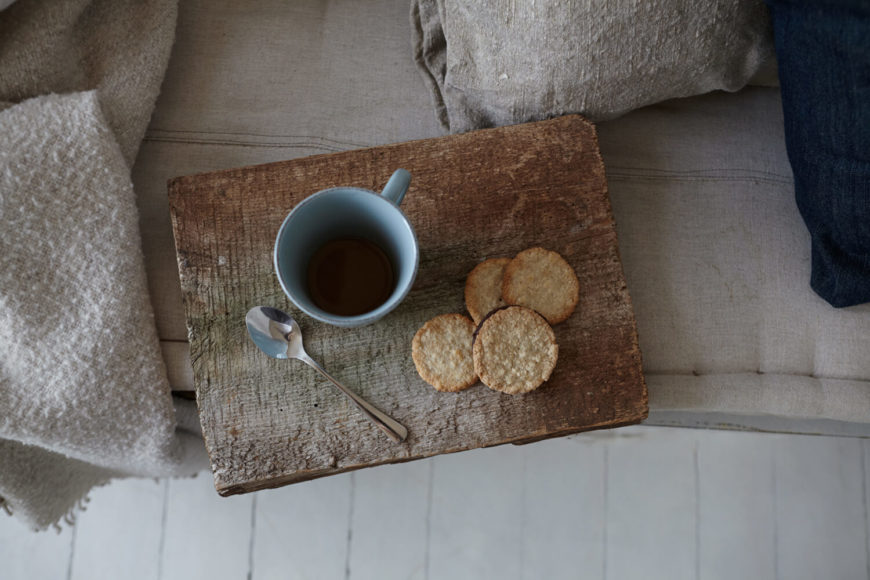 An aged wood block is used as a breakfast tray.