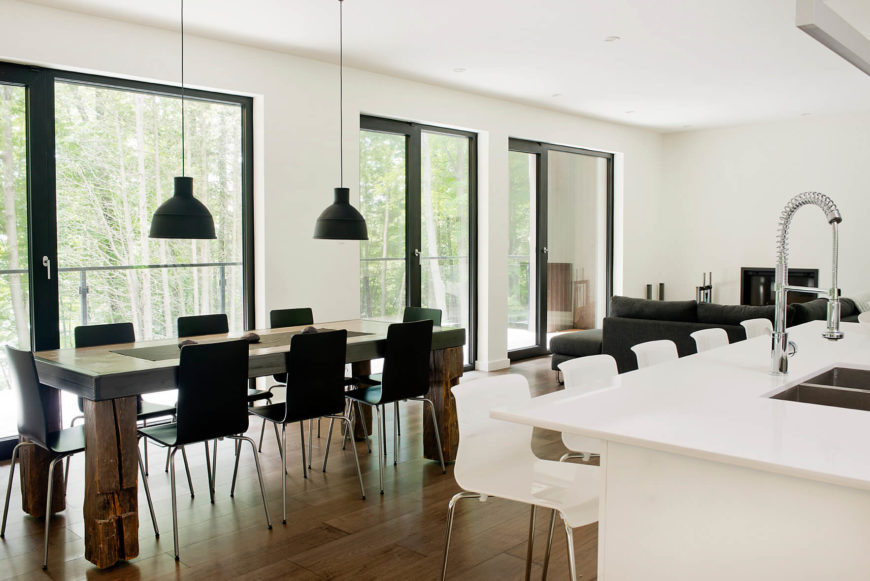 The wraparound terrace can be seen through massive sliding glass doors across the entire open-plan space.