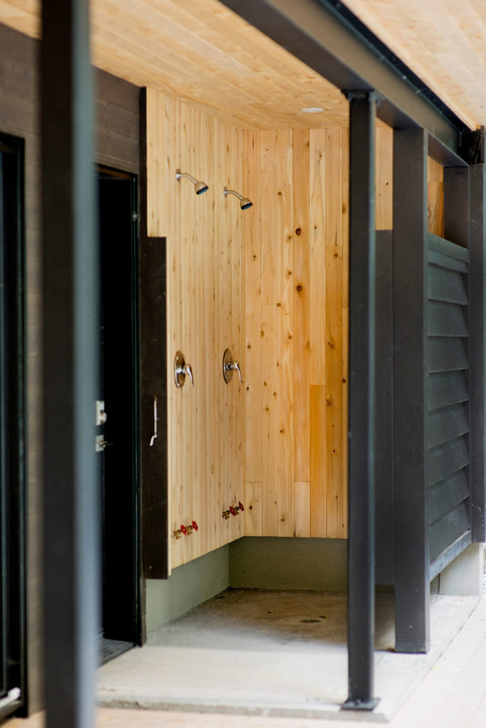 The wraparound patio also includes this useful outdoor shower, with hookups for hoses or appliances below.
