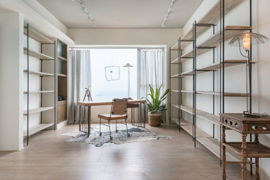 The study features an enchanting view of the cape. Opting to utilize a minimalist approach to this room, there's a sense of calm and the focus is steered out and over the water.