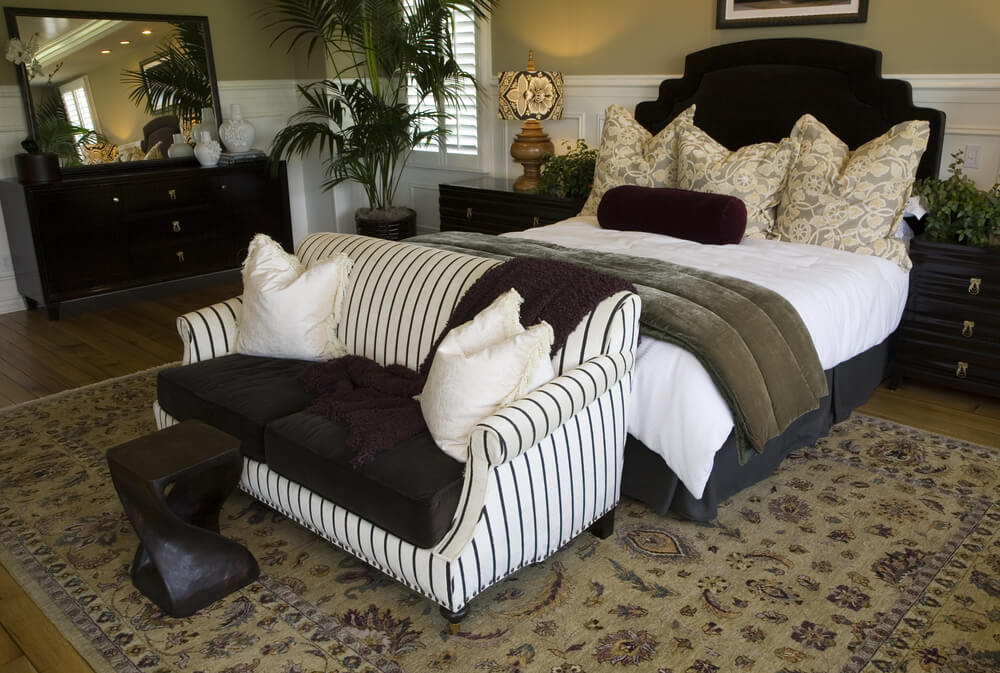 21 Stunning Primary Bedrooms with Couches or Loveseats ...
