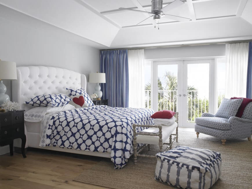 The light wood floor and natural fiber area rug add a bit of natural grounding to this airy white and blue design. The upholstered bed frame makes a statement for contemporary elegance.