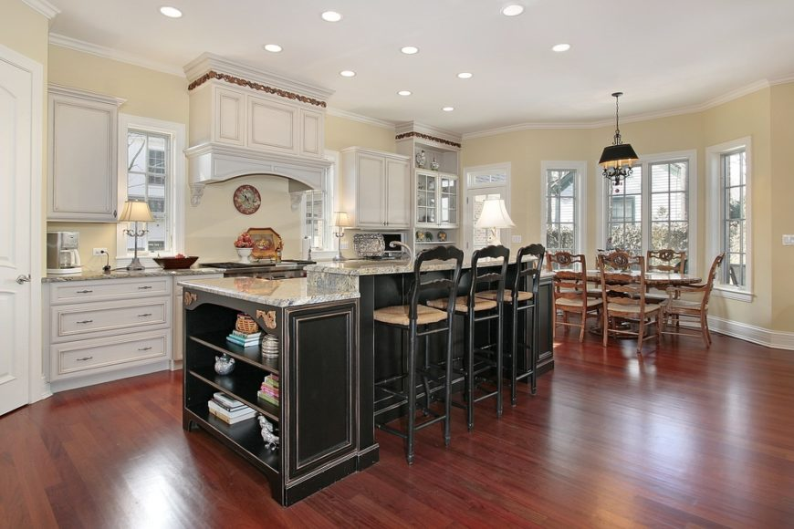 This elegant kitchen has beautiful colonial window panes that pair well with the classic design. Take note how the cabinet in the charming hoosier also houses colonial window panes for a harmonious arrangement.