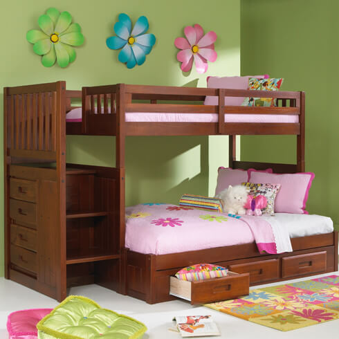 Here's a rich wood frame bunk bed designed for kids in need of compact storage, with a set of drawers beneath the lower bunk and a slim dresser built into the frame, beneath the stairs at left.