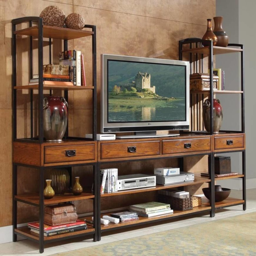 This sprawling entertainment center features dark wood and metal framework, with a pair of shelving towers flanking the surface space. Abundant storage drawers and shelving make for a truly useful setup.