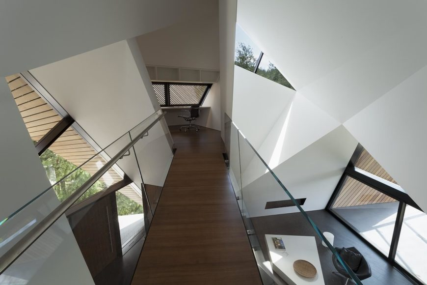 As we cross the bridge over the main living area, we approach a small doorway that makes the home feel as though it is tilting as you enter the study.