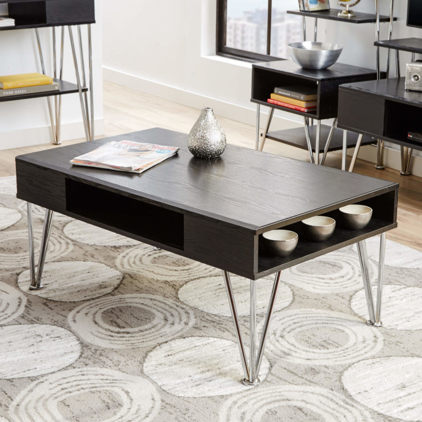 We begin our coffee table selection with a modern take on the classic rectangular design. With a wood top and built-in storage over chromed metal frame, this table is both attractive and highly utilitarian.