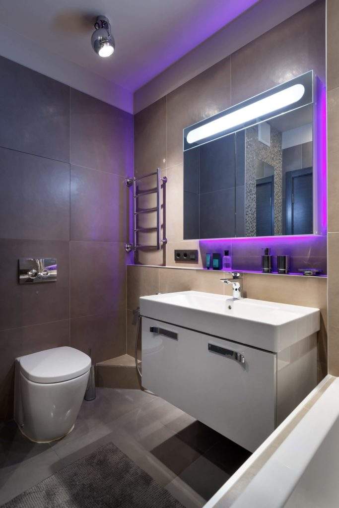 An unobtrusive commode is perfect for this modestly-sized bathroom, and the lights add a funky, yet modern effect.