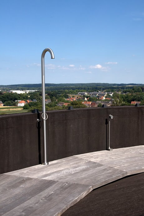 At the top of the home is the rooftop terrace, which features an outdoor shower and beautiful vistas of the neighboring town, airport, and of the open flatlands.