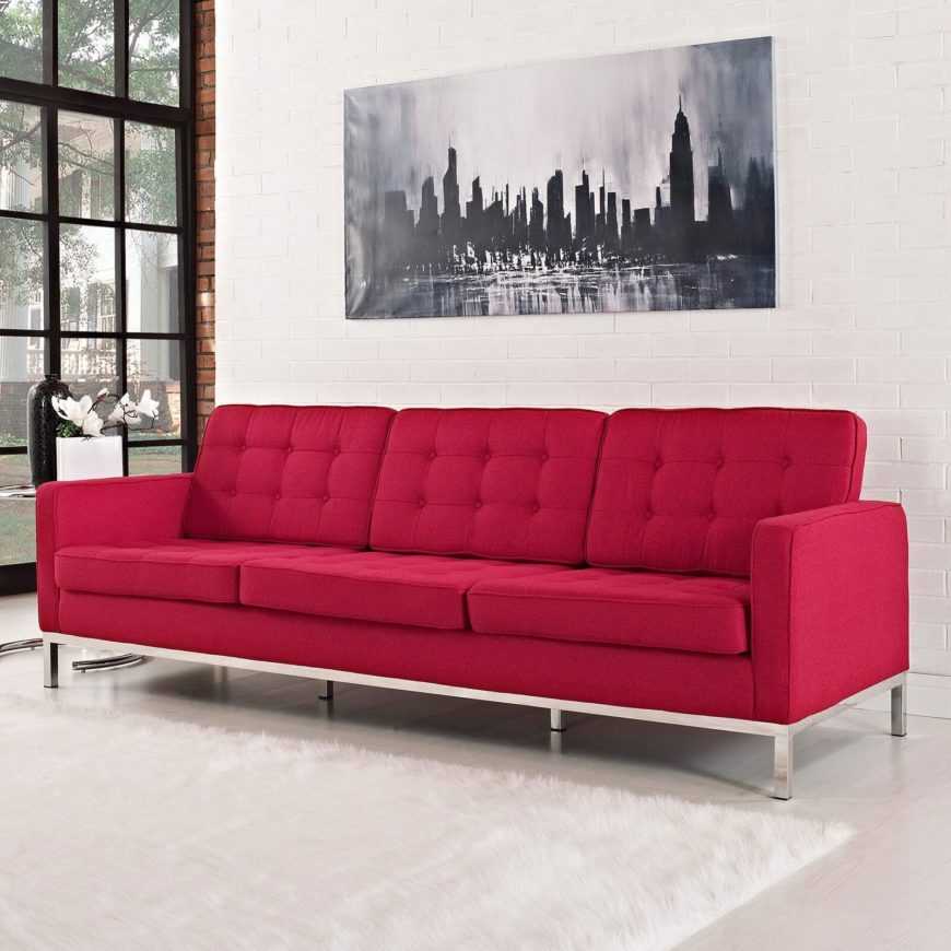 This bright red contemporary sofa sports clean lines and a bespoke, button tufted set of cushioning. The size and sleek style makes it appropriate for any modern or contemporary space.