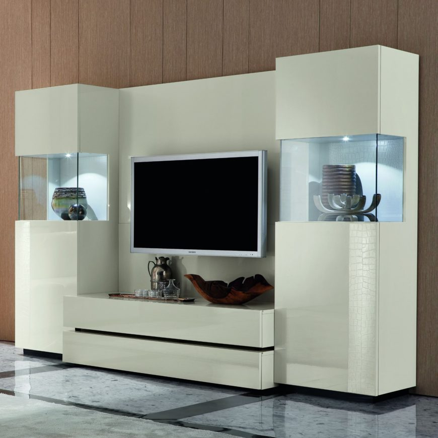 This ultra-modern entertainment center is equipped with a pair of inner-lit display cases flanking the main body, perfect for those with nicknacks, trophies, or artwork to show off. The sleek white construction adds perfect contrast to any rich room.