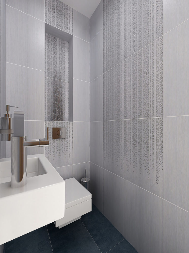 This small half bath builds around the rigid square of the wall tiles and is reflected in the sink and toilet shapes. Small tiles run down the walls, reminiscent of falling rain.