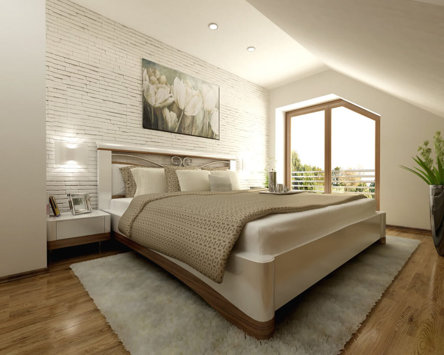 The primary bedroom uses the wood from the other bedrooms in a more understated fashion. It accents the bottom of the bed frame and bedside tables and balances out the extensive use of white in the room. More bold texturing is apparent in here as well.