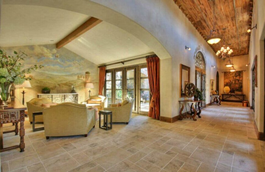 In a luxurious Tuscan-style mansion, a pastoral mural on a wall isn't an uncommon sight, but it is just as beautiful as you'd imagine. The light colors pull color out of every detail in this room.