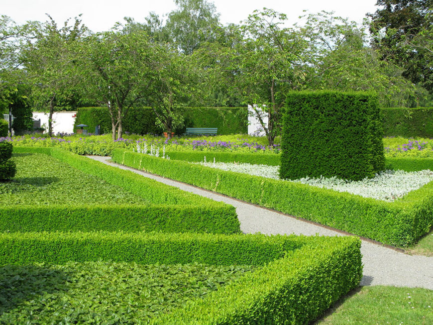 The dark green of the tall hedge in the center of the garden acts as an anchor for the lines of bright green radiating outward from it. It also helps to balance to amount of lighter green that could otherwise become overwhelming.