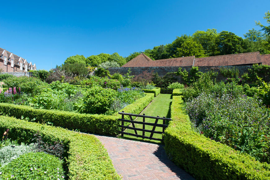 Utilizing low hedges to border pathways creates natural flow through a garden while offering an unobstructed view of the beautiful garden beds they surround.