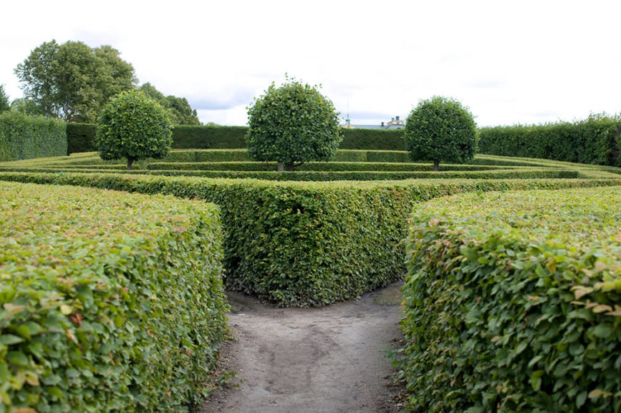 The opposing shapes in this garden create an interesting visual while the layered, flat hedges break up the large space.