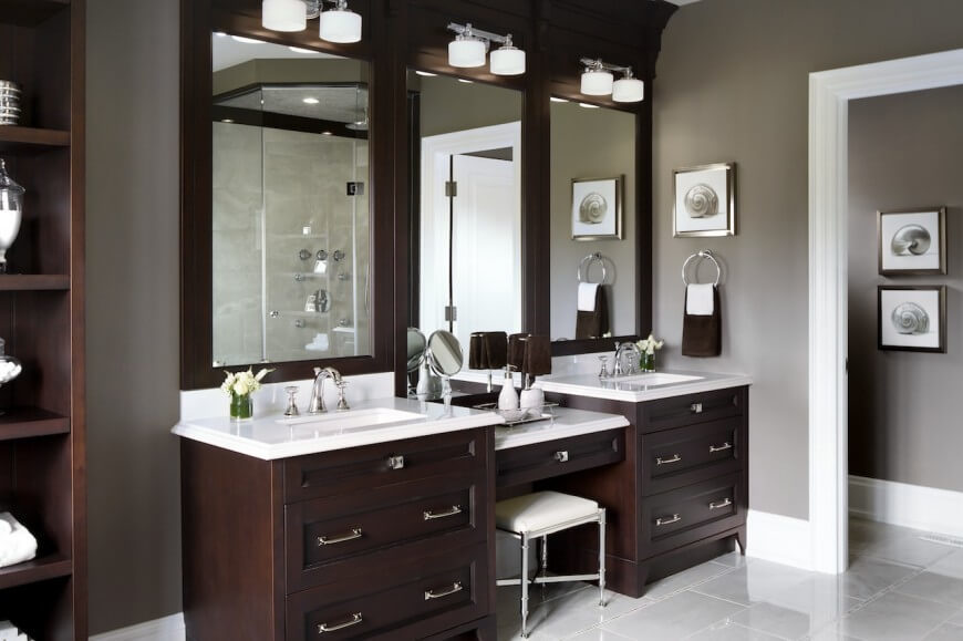 This vanity is has lots of dark natural wood and storage space. A space between the two sinks gives the residents a place designated for beauty and pampering.