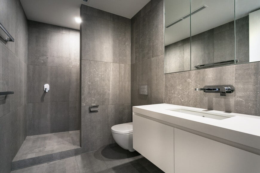 This entire bathroom has large format tile all around. The shower does not have a door, and gives a very open and spacious feeling to this room.