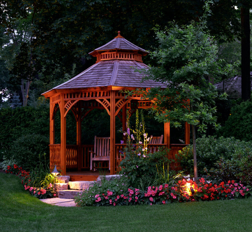 This beautiful piece features a breathtaking gazebo. Flowers in all different colors surround the deep amber wood of the structure.