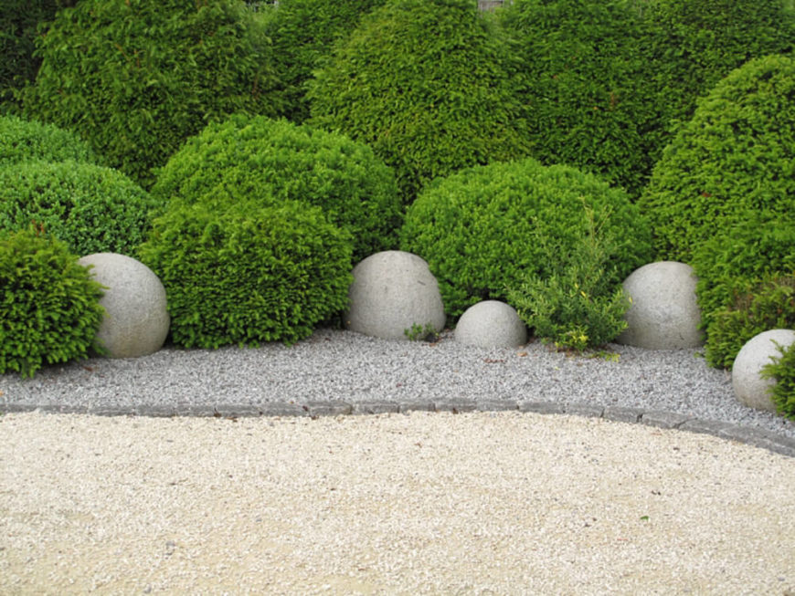 This garden brings to mind the calming zen of a traditional Japanese garden. The use of round shapes along side rocks and gravel is a common theme in these gardens.