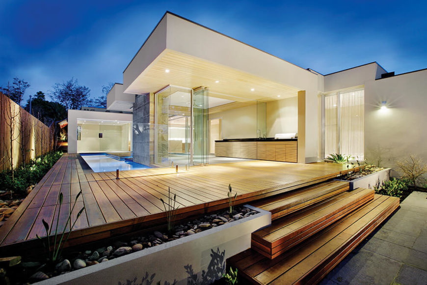 Modern minimalist home with expansive deck and pool design.