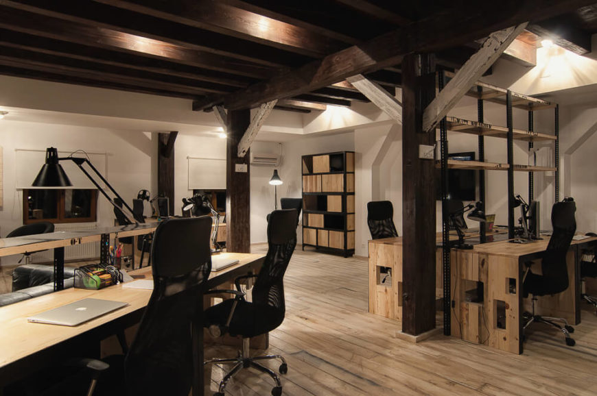 A full view of the main space of the office, filled with light and dark natural wood.