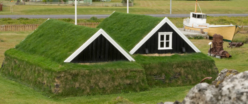 Soaring across the ocean to the island nation of Iceland, we see this turf-encased home with a lawn that runs right up the side of the structure and onto the pair of A-frame roofs, creating a holistic approach to rural living.