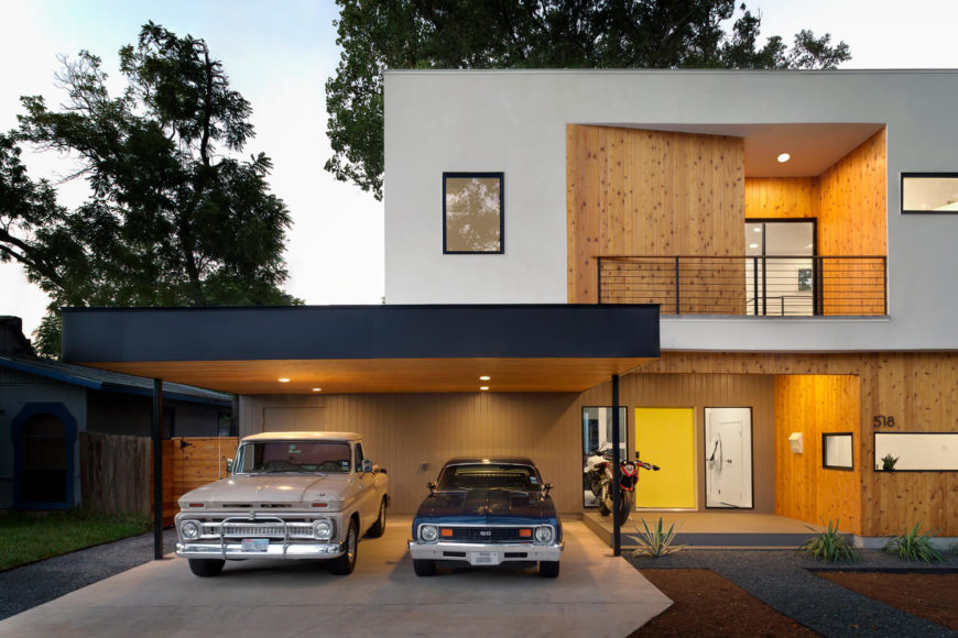 At dusk, recessed lighting in the overhands makes the outdoor areas glow, with natural wood paneling adding a natural warmth to the street side presentation.