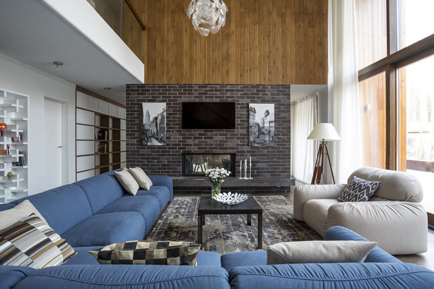 Gorgeous living room with blue, with brick and wooden panelling.