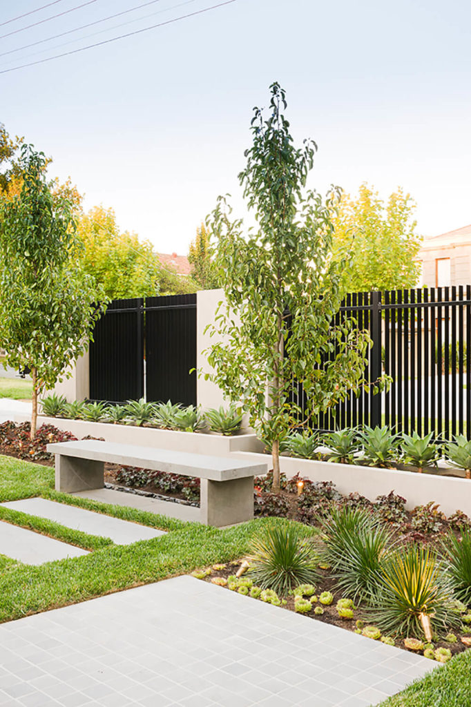 The concentric rings of garden layers wrapping the inner fence area help the transition into the central courtyard, and the home interior. The waves of natural - but precisely positioned - plant life echo the philosophy behind the home's style.